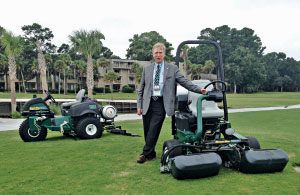 Jim Coker of R&R Products stands with propane-powered mowers about to be shipped to Stone Mountain (Ga.) GC.