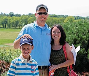 Matt and Cammie Henkel with son Ashton at PrairieView GC, Byron, Ill.