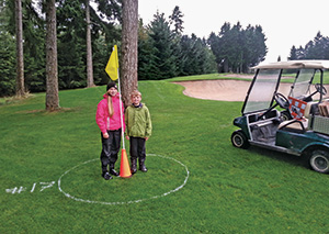 More popular than the big cups with Mike Kearns' kids, Cameron and Aidan, was a FootGolf setup they helped with.