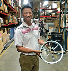 Scott Melling of Par Aide displays the blade designed to cut the 15-inch cup.