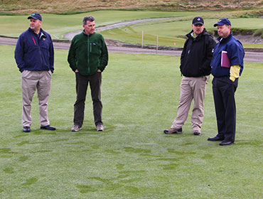 Darin Bevard, Eric Johnson, Josh Lewis and Mike Davis discuss course set-up during a walk-through in mid-March.