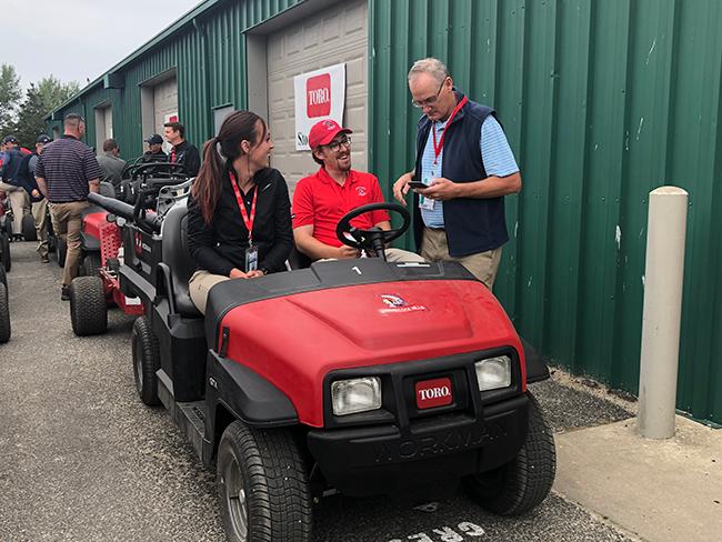 PGA Tour's senior director of Championship Agronomy talking to crew members