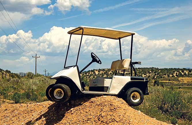 Golf cart stuck on top of dirt mound Photos courtesy of: Stock.com/GregC (1); Matt Cavanaugh