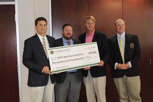 Carolina GCSA representatives present $107,000 check for turfgrass research
