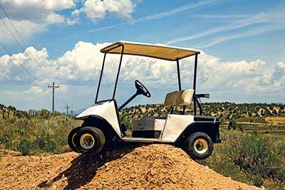 Golf cart stuck on dirt mound