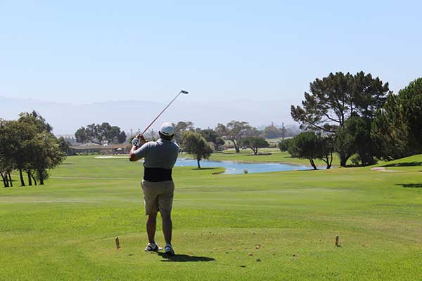 A golfer takes a swing at The Club at Crazy Horse in Salinas, Calif. during Youth on Course's 100 Hole Hike. (Photo: Youth on Course)