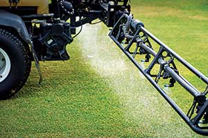 Close-up golf course spray application (Photo: PBI-Gordon)