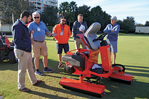 Smithco team showing off greens rollers (Photo: Kelly Limpert)