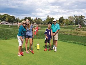 Family on a green at Cattail Creek Mini Course (Photo: Kevin Atkinson)