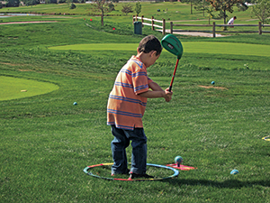 Child teeing off on Cattail Creek Mini Course (Photo: Cattail Creek Mini Course)