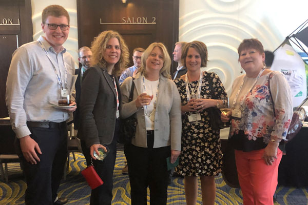 Pictured from left at the welcome reception are Kevin Finnegan, FMC Corp.; Jill Holihan, FMC Corp.; Ona Maune, Bayer; Carrie Tackema, Nufarm Americas; and Julie Schlekau, Valent. Photo: RISE