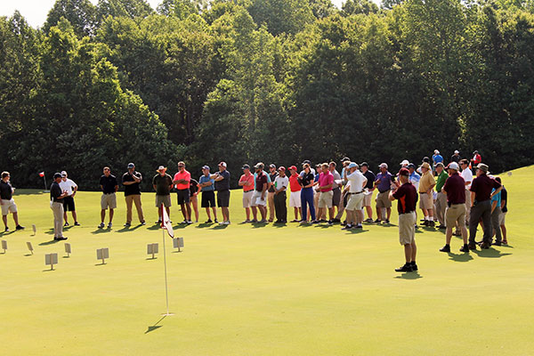 Turfgrass professors set up displays of different turfgrasses and diseases on the fairways and greens of Independence Golf Club. (Photo: Virginia Golf Course Superintendents Association)