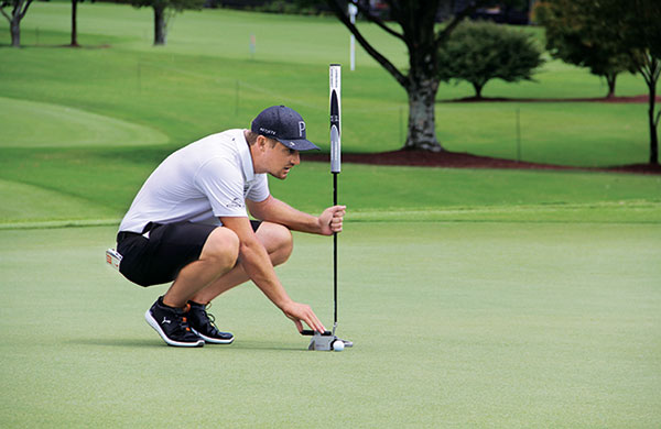Bryson DeChambeau lines up putts during the practice rounds of the Tour Championship at East Lake. (Photo: Seth Jones)