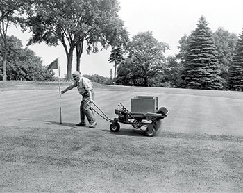 An early topdresser featured a wooden hopper and slats. (Photo: Turfco)