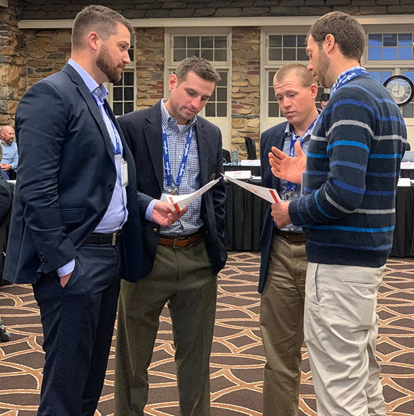 Jason Tharp, Scott Rettmann, Kevin Mark and Ian Schlather serve as representatives from several breakout groups who have to work together to negotiate an agreement during a breakout session at the Syngenta Business Institute. (Photo: Golfdom Staff)