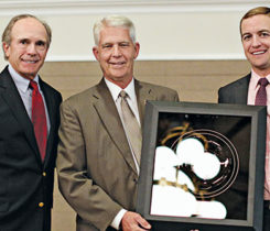Frank Siple (middle) with his Distinguished Service Award, presented by past U.S. Open champion Jerry Pate, left, and Jamie Pate, of the Jerry Pate Co., right. (Photo: Georgia GCSA)