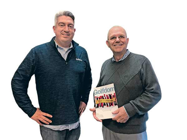 Golfdom Editor-in-Chief Seth Jones (left) and Mike Kenna, Ph.D, with the December 2019 issue of Golfdom. (Photo provided by Golfdom Staff)