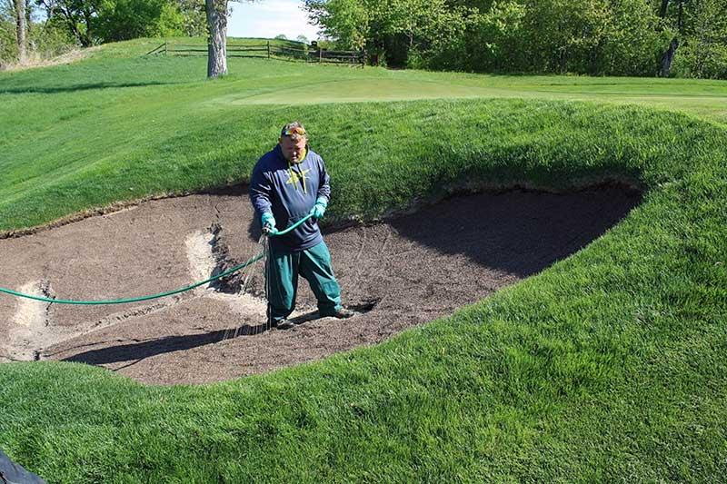 Klingstone, a liquid-applied polymer bunker barrier, is applied to a bunker at Spring Hill Golf Club in Wayzata, Minn. (Photo: Tim Johnson)