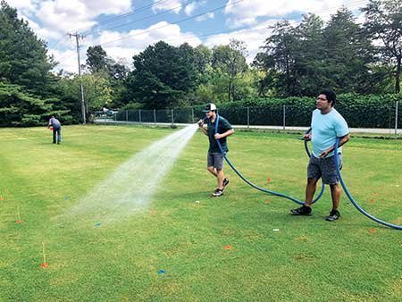 David McCall's students conduct a postapplication study with wetting agents for control of spring dead spot. (Photo: David McCall)
