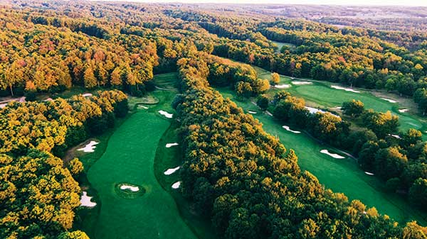 An aerial view of the Signature Course. No. 3 is located back right, No. 5 is located in the middle and No. 6 is located on the left side. Rick Smith designed the course after a trip overseas to Scotland and Ireland. It has 135 bunkers. (Photo: Treetops Resort)
