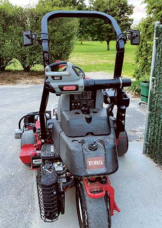 These greens mowers tackle North Hempstead CC's 22 greens with handheld blowers and backup batteries. (Photo: Tom Kaplun)