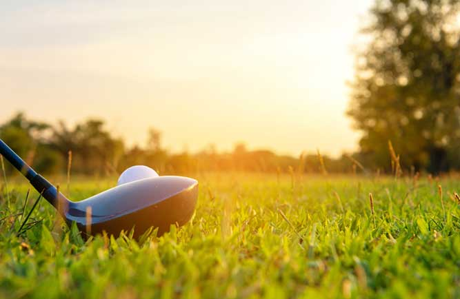 Golf club and ball about to tee off (Photo: Wand_Prapan / iStock / Getty Images)