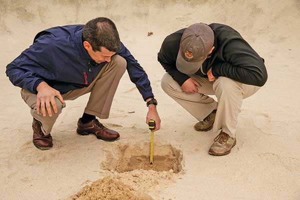 Evaluating bunkers (Photo courtesy of the USGA)
