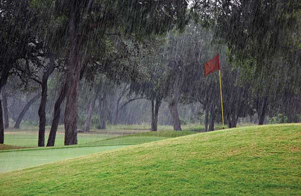 Rain on golf course (Photo by: dlanier / E+ / Getty images)