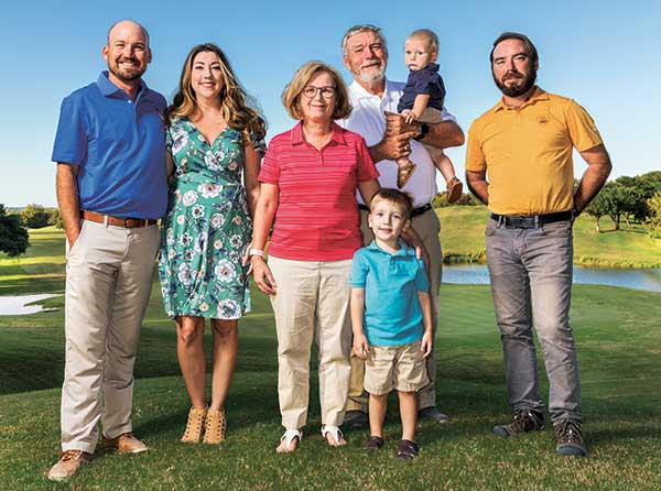 Travis, Carly, Kay, Wyatt, Jim, Shane and Andrew Moore spend many a family meal talking turf. (Photo: Jeff WIlson)