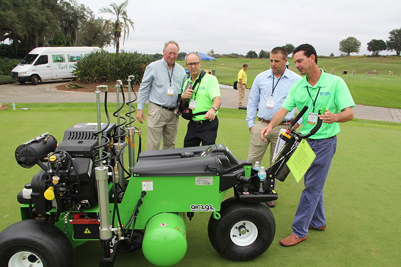 Glen Black, Air2G2 founder, (second from left) leads a demonstration of the Air2G2 at the Golfdom Summit. (Photo: Golfdom Staff)