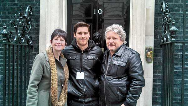 Zack Merrick (center) with his parents Carla and Mark Merrick in front of 10 Downing Street in London. (Photo courtesy of Mark Merrick, CGCS)