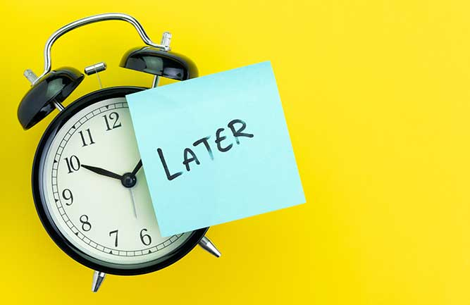 Clock with later sticky note posted to it (Photo: Nuthawut Somsuk / iStock / Getty Images / Getty Images Plus)