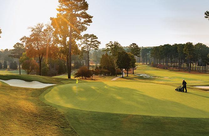 A crew member prepares Atlanta Athletic Club ahead of the Women's PGA Championship. (Photo: John Deere)