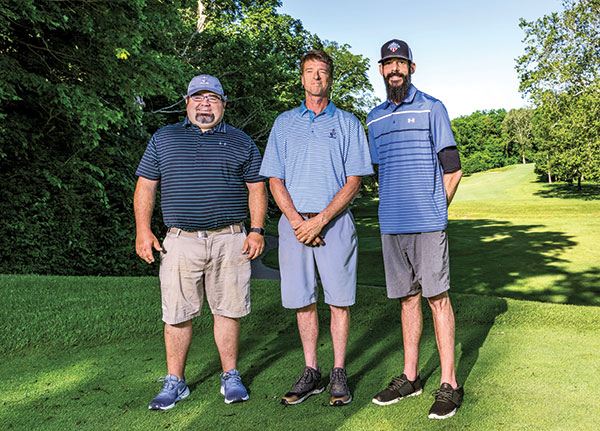 """Burke and Ferone with assistant superintendent Bob Herr (left.) """"There are hundreds of guys in the industry like Bob, who are so dedicated and deserve to be in a magazine more than me,"""" Ferone says. (Photo: Matthew Allen)"""