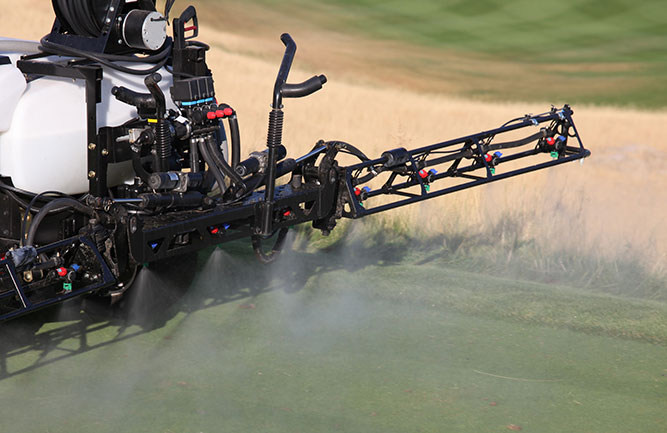 Sprayer putting down fungicide (Photo: ImagineGolf / E+ / Getty Images)