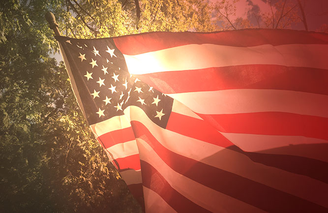 American flag with sunlight in background (Photo: iStock/Getty Images/Getty Images Plus/IrisImages)