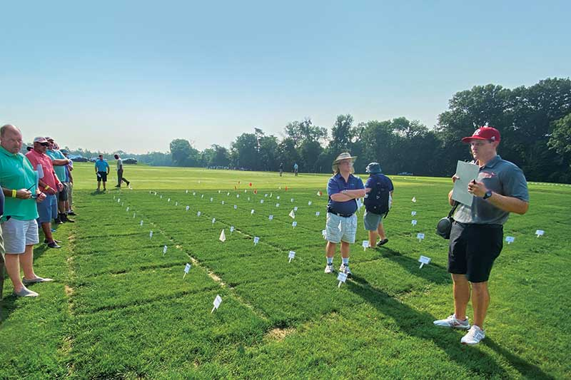 Phillip Vines, Ph.D., discusses developing gray leaf spot resistance in perennial ryegrasses at the 2021 Rutgers Turfgrass Field Day. (Photo: Mike Kenna)