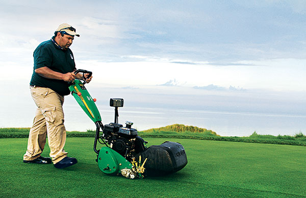 Employee working on golf course (Photo: Golfdom Staff)
