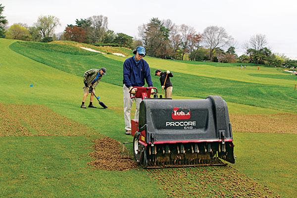 Golf course employee aerating. (Photo: Golfdom Staff)