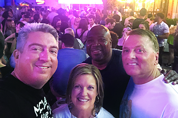 Golfdom Editor-in-Chief Seth Jones (left) was happy to not only get out to enjoy a concert, but also to make some new friends in the industry by meeting PBI-Gordon's Brett Rieck (right) at the concert (with wife, Dana and Seth's friend Sean Lipford in back). (Photo: Golfdom Staff)